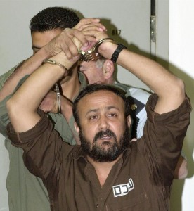 LEADER OF THE PALESTINIAN UPRISING MARWAN BARGHOUTI ENTERS INTO A TEL AVIV COURTROOM.